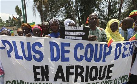 Citizens of Mali protest during the ECOWAS meeting, where the Mali crisis and Guinea-Bissau coup are discussed, in Abidjan